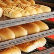 Fresh bread on tray rack from side — Stock Photo #8813943