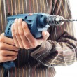 Stock Photo: Hand hold electric powered drill
