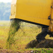 Stock Photo: Close up of paddy harvest machine from back