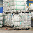 Stockfoto: Stack of paper waste at recycling plant