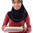 Beautiful young muslim lady smile passing report book — Stock Photo
