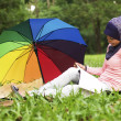 Beautiful young muslim lady read book — Stock Photo