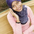 Beautiful young muslim lady smiling talk to the mobile phone — Stock Photo #8818541