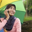 Stock Photo: Beautiful young muslim lady talk to mobile phone
