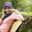 Beautiful young muslim lady with mobile phone — Stock Photo #8818811
