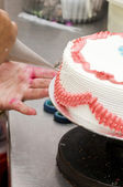 Cake decoration process — Stock Photo