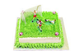Football cake with player miniature — Stock Photo