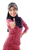 Beautiful young muslim women shows thumbs in smile — Stock Photo