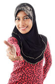 Beautiful young muslim women smile while extend her hand — Stock Photo