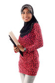 Beautiful young muslim holding books smile — Stock Photo