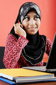 Beautiful young muslim lady talk to the phone — Stock Photo
