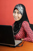Beautiful young muslim smile infront of notebook — ストック写真