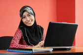Beautiful young muslim woman smile while working — Stock Photo