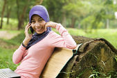 Beautiful young muslim lady with mobile phone — Stock Photo