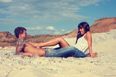 Young beautiful girl and guy in love outdoors — Stock Photo