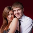 Couple embracing on the red background — Stock Photo