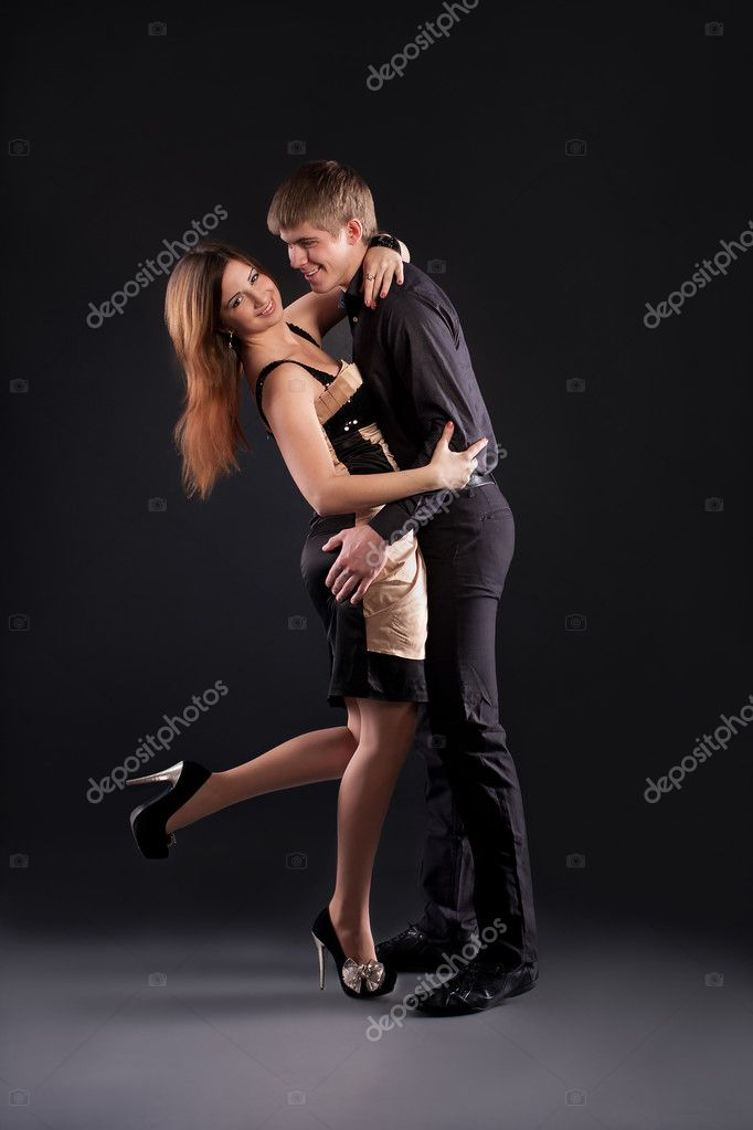 Sexy couple dancing on a black background — Stock Photo #8756457