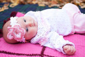 Beautiful girl in a pink baby clothes — Stock Photo