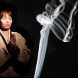 Incense smoke and Asian woman. — Stock Photo #8145125