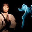Woman and blue incense smoke. — Stock Photo #8145129