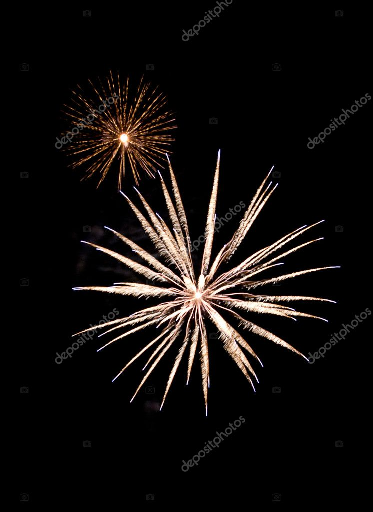 A burst of two different fireworks against the dark sky in celebration — Stock Photo #8339770