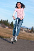 Girl on a scooter. — Stock Photo