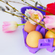 Eggs with tulip flowers and willow branches — Stock Photo #9408220