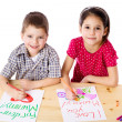 Stock Photo: Two smiling kids draw for mum