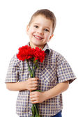 Smiling boy with bouquet of carnations — Stock Photo