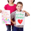 Two kids with greetings for mum - Stock Photo