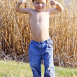 Strong kid showing the muscles — Stock Photo #10214599
