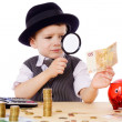 Royalty-Free Stock Photo: Little businessman checks the money