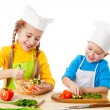 Two smiling kids mixing salad — Stock Photo #10225980