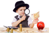 Little businessman checks the money — Stockfoto