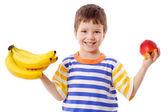 Ragazzo felice tiene una banana e mela — Foto Stock