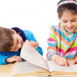 Two kids reading the book — Stock Photo #10429097