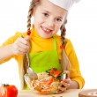 Little chef mix the salad — Stock Photo