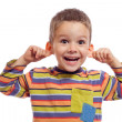 Little boy with funny face - Stock Photo