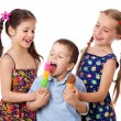 Two girls and boy with ice cream — Stock Photo #10491709