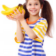 Happy girl holds a bunch of bananas — Stock Photo #10558801