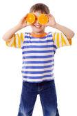 Funny boy with fruits on eyes — ストック写真