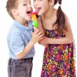 Royalty-Free Stock Photo: Girl and boy eating ice cream together