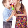 Girl and boy eating ice cream together — Stock Photo