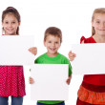 Three kids standing with empty blank — Stock Photo