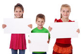 Three kids standing with empty blank — Stock Photo
