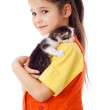 Little girl with kitty on shoulder — Stock Photo