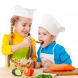Two kids eating salad — Stock Photo