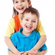 Two laughing little children standing together — Stock Photo