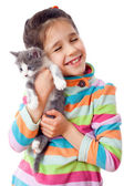 Happy little girl cuddle kitten — Stock Photo