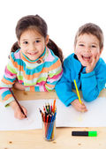 Two little kids draw with crayons — Stock Photo